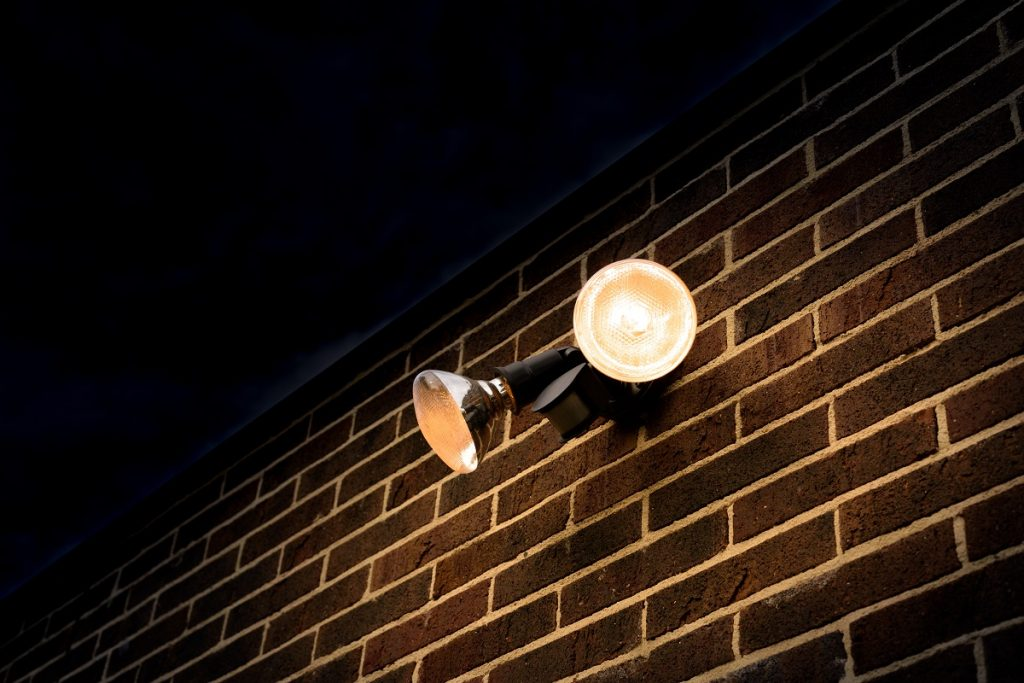 Home motion detector attached on the brick wall